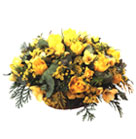 Yellow Tolips, Roses, Freesia and green accents in straw basket