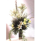 White Lilies, Yellow Roses with special greenery in glass vase