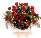 Roses combined with Hypericum, Pepper and Nephrolepis in straw basket