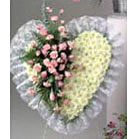 Beautiful Heart Design made of White Poms, and centered with Pink Roses, Pink Carnations, fresh mixed greens