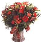 Black Beauty Roses with Tulips combined with Grevillea and Pine Cone wrapped with red ribbon in tin vase