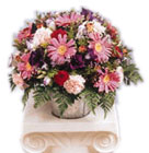 Pink Gerbera, Phlox, Red Rose, Carnation, Liziyantus and Leather fern in tin vase